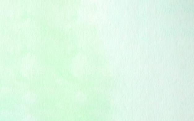 Blaue und grüne abstrakte aquarellmalerei gemasert auf weißbuchhintergrund