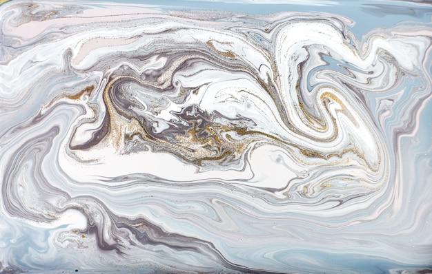 Blaue und lila malerei mit goldenem funkeln. abstrakter flüssiger hintergrund.