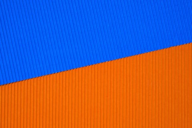 Blaue und orangefarbene wellpappen
