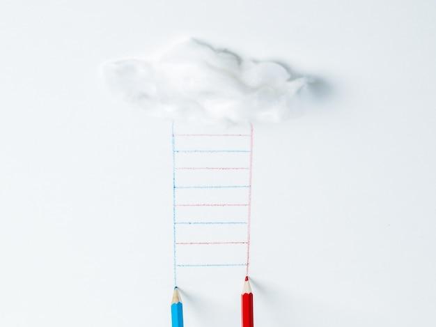 Blaue und rote stifte, die eine leiter von einer wolke zeichnen. das konzept der entwicklung.
