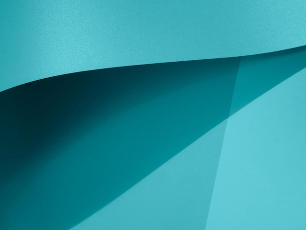 Blaue zusammenfassung der nahaufnahme gebogenes einfarbiges papier