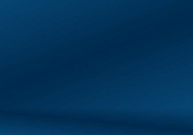 Blauer abstrakter hintergrund der steigung. glattes dunkelblau mit schwarzer vignette studio.