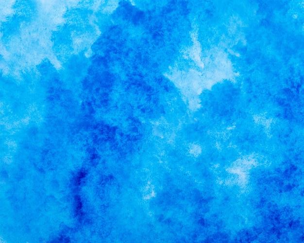 Blauer aquarell-spritzstrichhintergrund.