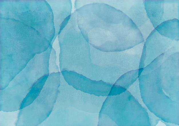 Blauer aquarellhintergrund mit farbstempel