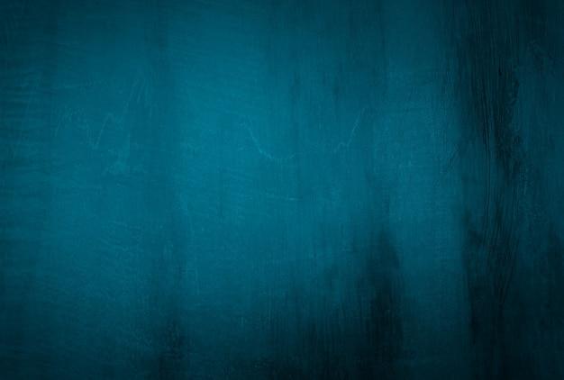 Blauer betonbeschaffenheitswandhintergrund der weinlese grunge mit vignette.