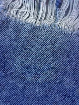 Blauer denimbaumwollstoff-beschaffenheitshintergrund. jeans zerrissene gewebebeschaffenheit