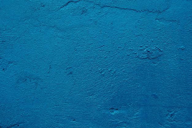 Blauer dunkler zement des schmutzes der abstrakten kunst oder beschaffenheitshintergrund der sauberen wand des betons