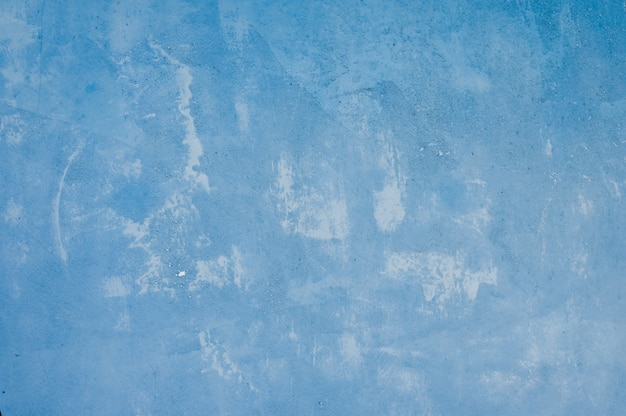 Blauer eisenhintergrund mit beschaffenheit. durchgesickerte farbe
