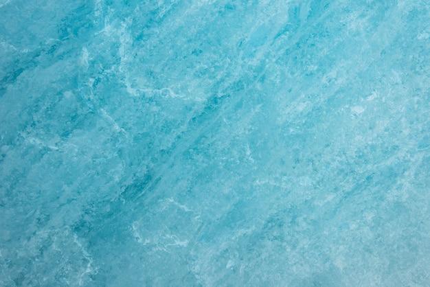 Blauer eishintergrund des gletschers
