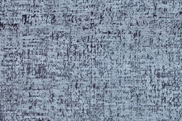 Blauer flauschiger hintergrund aus weichem, flauschigem stoff. beschaffenheit der textilnahaufnahme