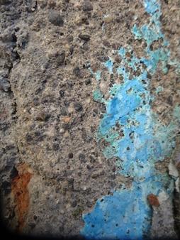 Blauer fleck auf grau grunges