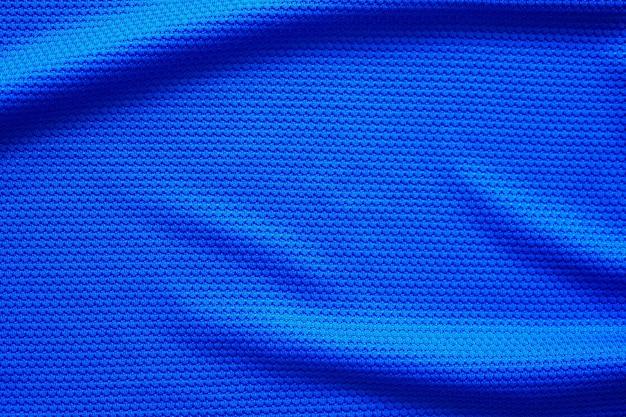 Blauer fußballtrikotkleidungstextur-sportabnutzungshintergrund, nahaufnahme oben