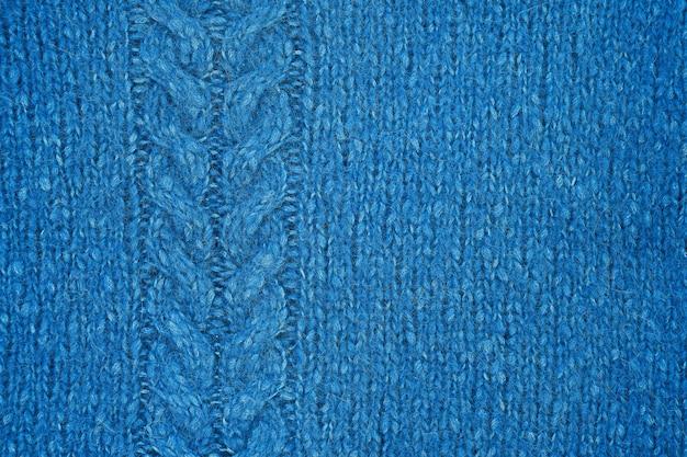 Blauer gestrickter beschaffenheitshintergrund. handgemachte strickwaren.