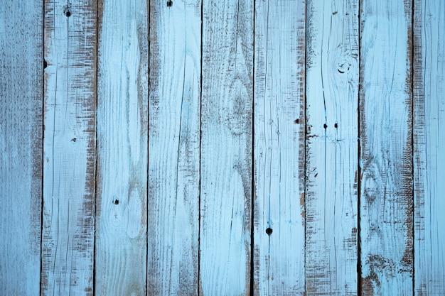 Blauer hintergrund des hölzernen brettes der flachen lage