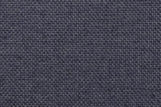 Blauer hintergrund mit umsponnenem kariertem muster, nahaufnahme.