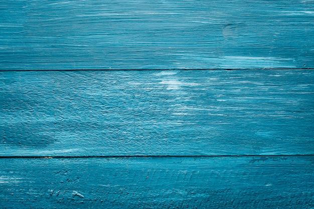 Blauer hintergrund von gemalten brettern