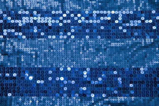 Blauer paillettenhintergrund