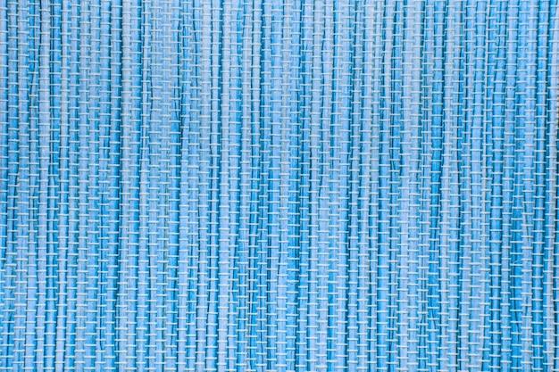 Blauer papiermattentexturhintergrund kann für vertikalen vorhang verwendet werden