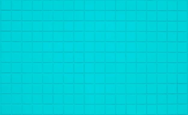 Blauer pastellfliesenwandbeschaffenheitshintergrund