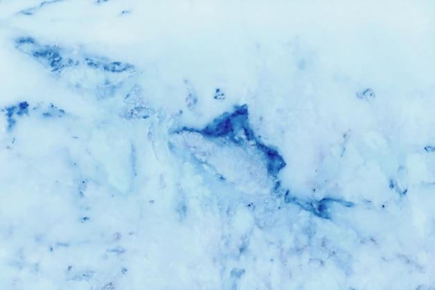 Blauer pastellmarmorbeschaffenheitshintergrund.