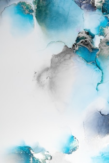 Blauer silberner abstrakter hintergrund der kunstmalerei der flüssigen marmortinte auf papier.