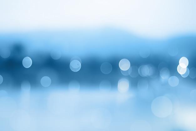 Blauer steigungshintergrund oder bokeh zusammenfassungsdesign