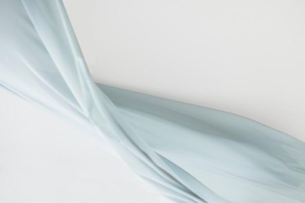 Blauer stoffbewegungsbeschaffenheitshintergrund