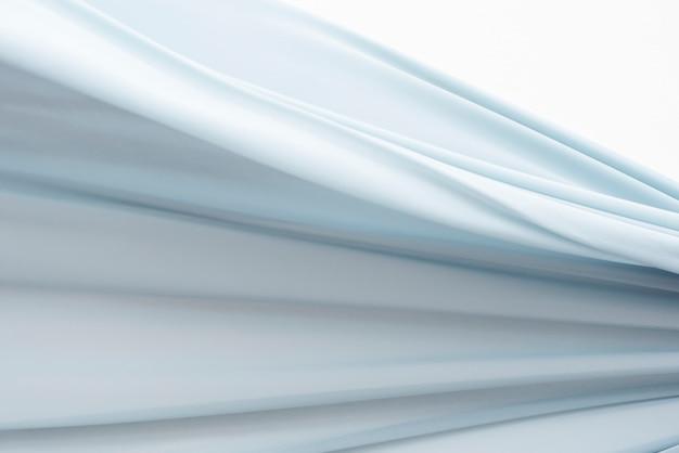 Blauer stoffbewegungshintergrund
