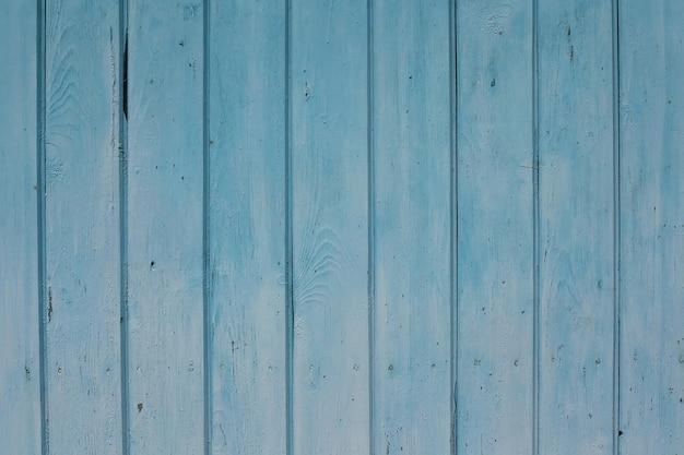 Blauer strukturierter zaunhintergrund aus holz