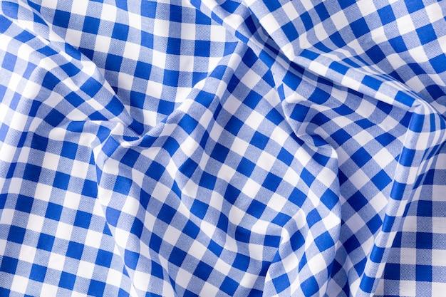Blauer tischtuch-beschaffenheitshintergrund
