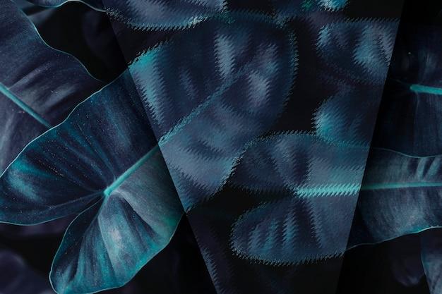 Blauer tropischer blatthintergrund