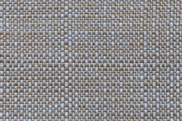 Blauer und brauner textilhintergrund mit kariertem design, nahaufnahme. struktur des gewebemakros.