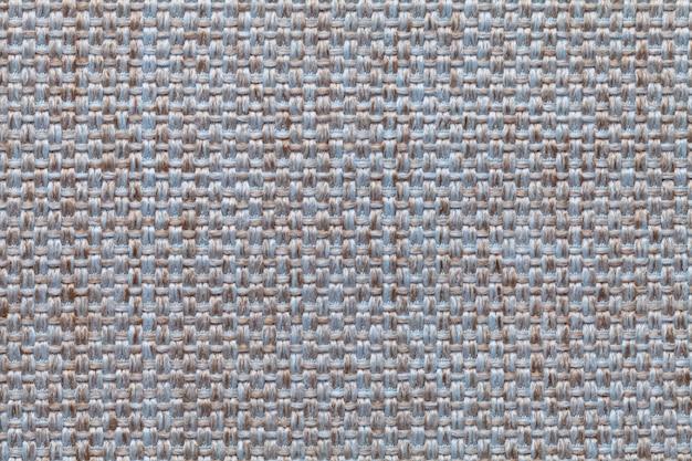 Blauer und brauner textilhintergrund mit kariertem muster, struktur des gewebes