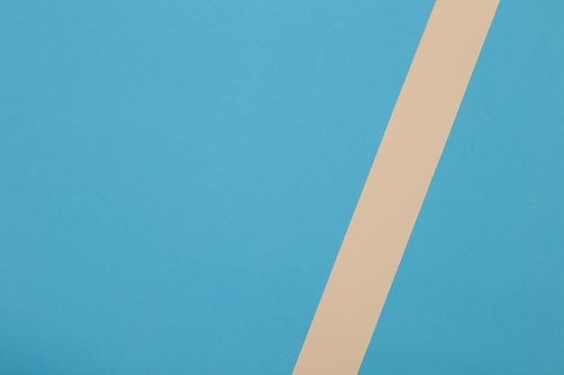 Blauer und gelber hintergrund, farbiges papier unterteilt sich geometrisch in zonen