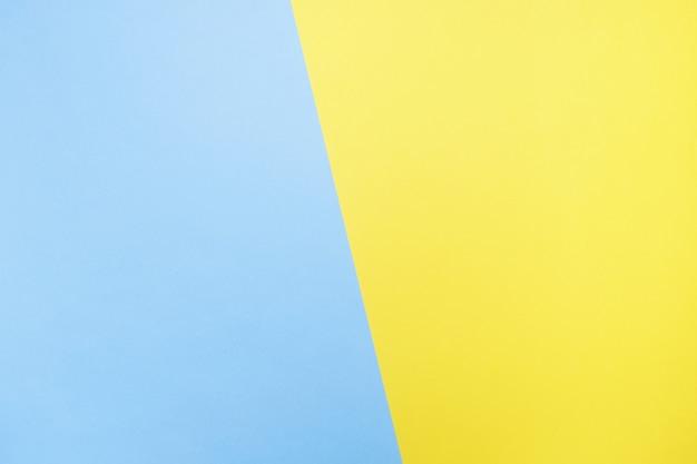 Blauer und gelber hintergrund. papierbeschaffenheit nahansicht