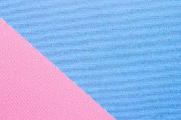 Blauer und hellrosa pastellpapierhintergrund