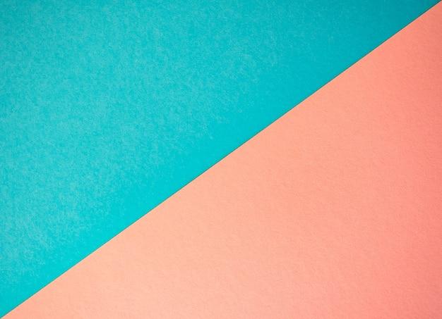 Blauer und rosa papierhintergrund. flaches design