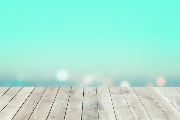 Blauer verschwommener himmel mit holzplanken-produkthintergrund
