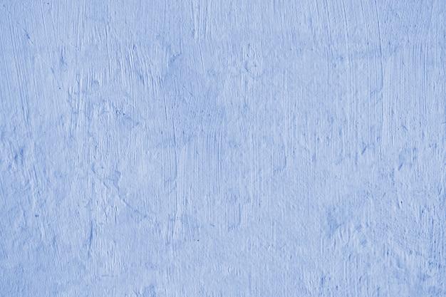 Blauer wandbeschaffenheitshintergrund