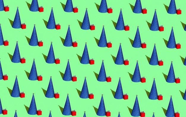 Blauer weihnachtsbaum in form eines kegels mit einem roten geschenk auf grünem hintergrund weihnachten nahtlose p...
