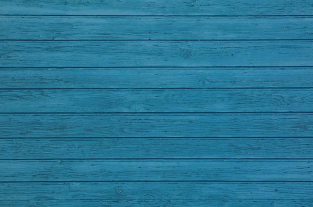 Blauer weinlese gemalter holztafelhintergrund
