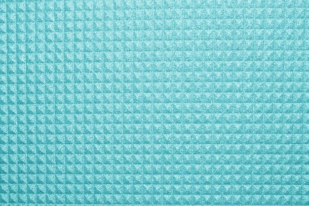 Blauer yogamattenbeschaffenheitshintergrund. hintergrund der campingmatte
