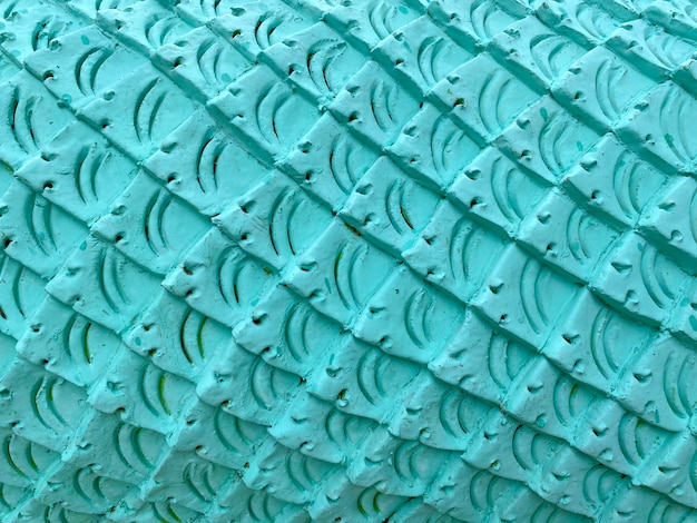 Blauer zementputz in fischhaut-kurvenmuster-textur-wandhintergrund.