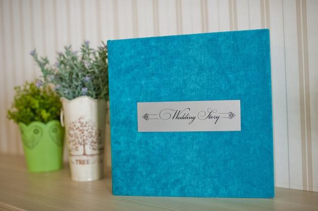 Blaues aquasamthochzeitsfotobuch und -album