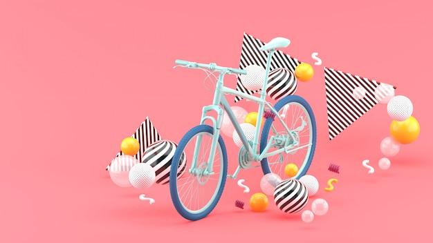 Blaues fahrrad unter bunten kugeln auf rosa. 3d rendern.