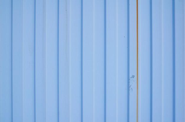 Blaues metalleisenblech mit vertikalen streifen
