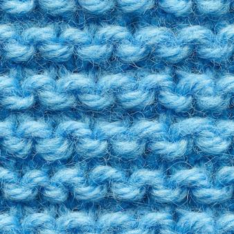 Blaues nahtloses strickmuster für randlose füllung. strickstoff wiederholt sich