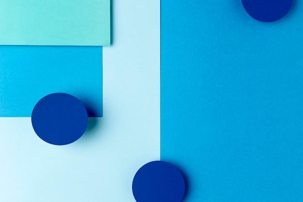 Blaues papier formt hintergrunddesign