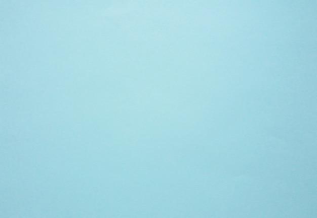 Blaues papier in pastellfarben. abstrakter blauer hintergrund.