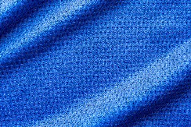 Blaues stoff-sportbekleidungs-fußball-trikot mit air-mesh-textur-hintergrund
